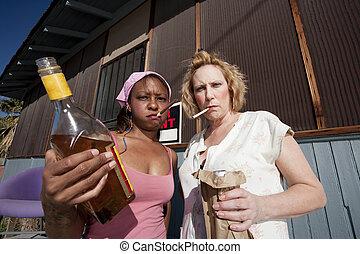 Drunk Women - Portrait of two trashy drunk women outdoors
