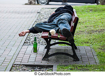 Drunkard on bench - A homeless drunkard sleeping on a bench...