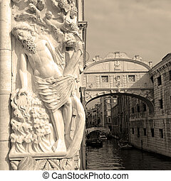 Drunkenness of Noah, relief sculpture by Filippo Calendario on Doges' Palace; Bridge of Sighs in the background; seen from Ponte della Paglia, Venice, Italy, Europe