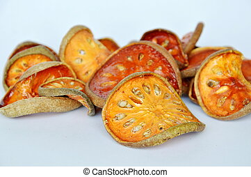 dry bael fruit on white background