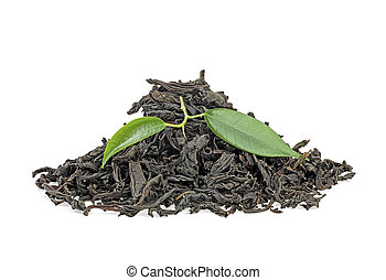 Dry black tea with green leaves isolated on white background