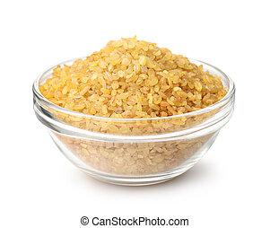 Dry bulgur wheat in glass bowl