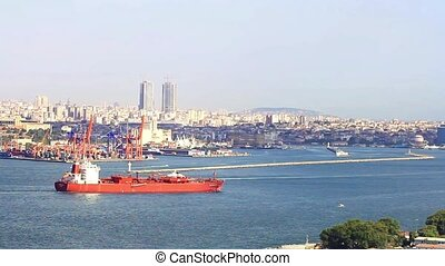 Bulk carrier ship sailing in front of Haydarpasa Seaport, Istanbul.