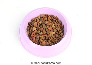Dry cat food in a purple pink bowl isolated on white background