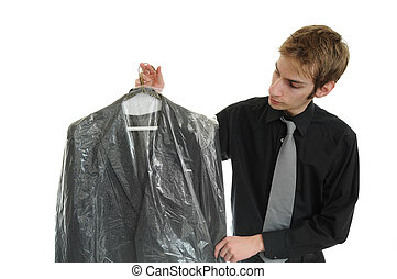 Dry Cleaned Suit - Young man holds newly dry cleaned ...