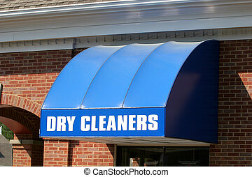 Dry Cleaners - A bright blue canopy over a dry cleaners ...