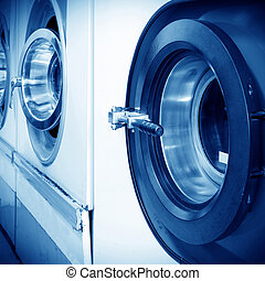 Dry-cleaning machines - Public laundry machines standing in...