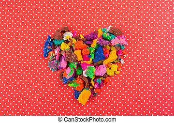 Dry colorful play dough in heart shape