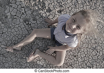 Dry Cracked Ground & Girl Sitting
