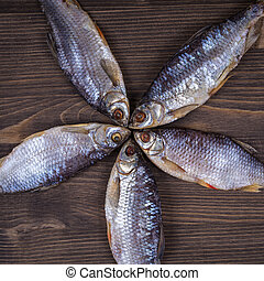 Dry fish on a wooden background