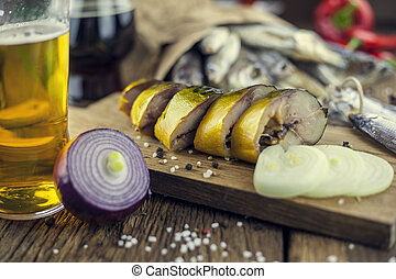 Dry fish on wooden background with beer,