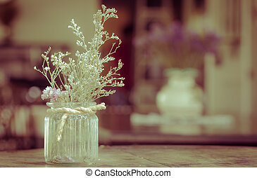 dry flowers in glass vase with rope on blurred background, copyspace. Vintage retro style