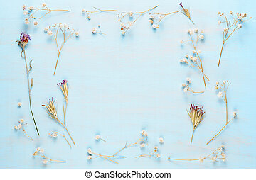 Dry flowers on blue wooden background