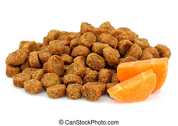 Dry food for dogs and cats with carrots.