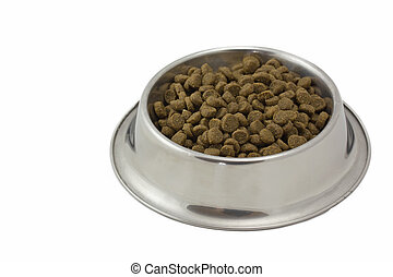 Dry food for dogs in a metal bowl