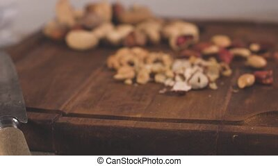 Dry fruits on wooden table - Walnuts, hazelnuts, peanuts and...