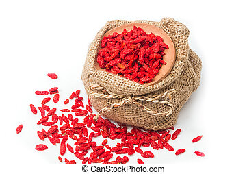 Dry goji berries in clay bowl on white background