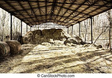 Dry hay under the roof, rural scene