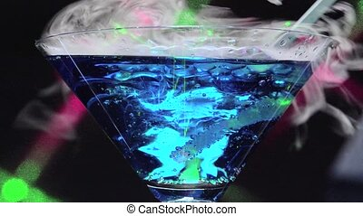 Dry ice in blue lagoon - closeup with black background and...