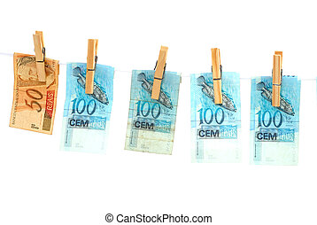Drying money after washing. Brazilian Real.