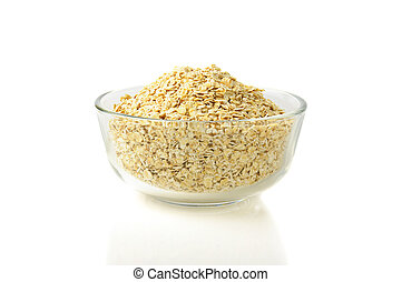 dry oat grains in glass bowl