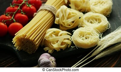 Dry pasta assortment on board
