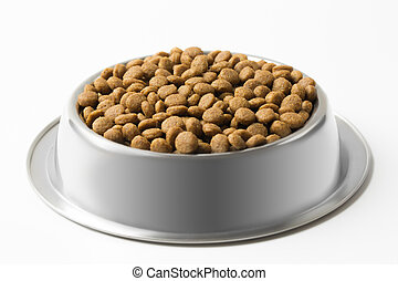 dry pet food in a metal bowl isolated on white background