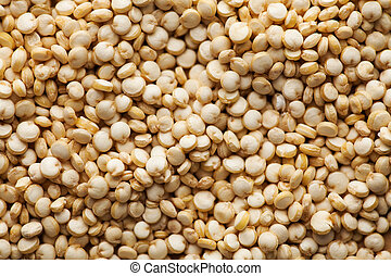 Dry quinoa croup closeup in full frame. Quinoa photo for recipes, grocery departments, for logo.