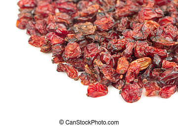 Scattered red berries of dry barberry on a white background