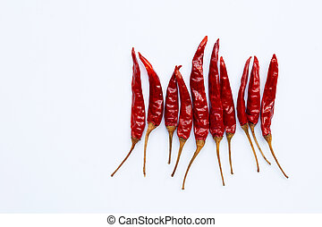 Dry red hot chili peppers on white background