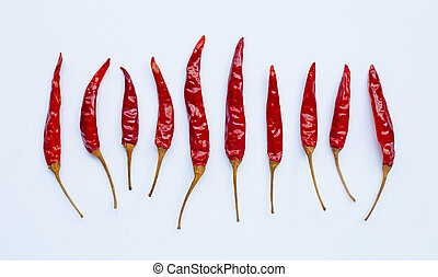 Dry red hot chili peppers on white