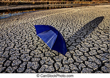 Dry River Bed cracked soil umbrella Canada Drought