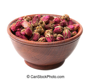 Dry rose in wooden cup on white background