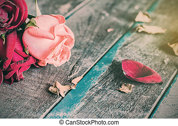 Dry roses on a wooden