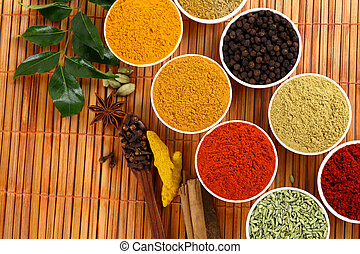 dry spicy powders on mat background