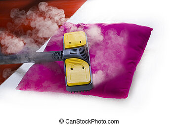 Dry steam cleaner in action. - Using dry steam cleaner to ...