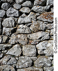 A traditional dry stone wall. Made from stones.