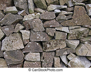 Close-up of a dry stone, farm wall.