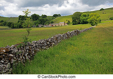 In the hills of England dry stone walls are made to divide fields as no hedges will grow in the shallow soil.