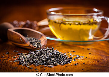 Dry tea on wooden table