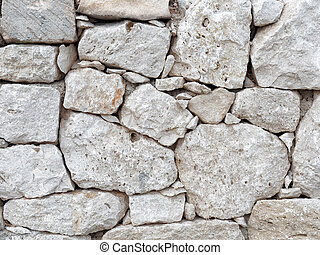 Dry wall of shaped stones front view