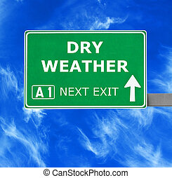 DRY WEATHER road sign against clear blue sky
