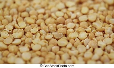 dry yellow peas close-up as background. preparation of...