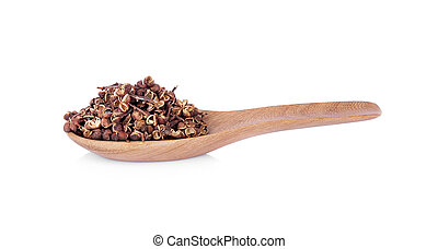 Dry Zanthozylum limonella Alston in wooden spoon on white background.