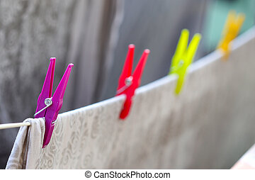 Drying bed linen - Colourfull laundry clips hold drying bed ...