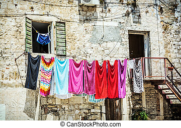 Drying clothes in front of the old house