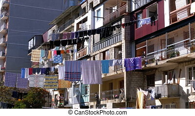 Drying clothes on a clothesline between houses in a poor...