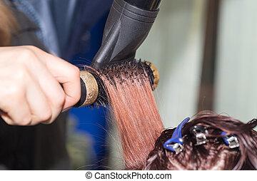 drying hair in a beauty salon