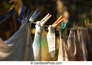 Drying laundry line - drying laundry line with clothes pegs...