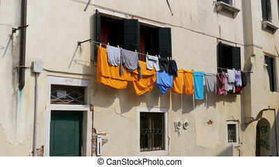 Drying Laundry Waving at the Old Italian Street, Venice.